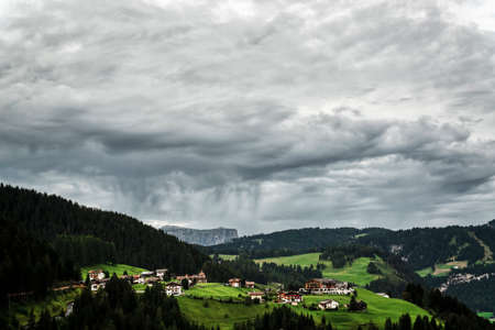Storm clouds over the little village of Gardena Valley, Alto Adige, Italy