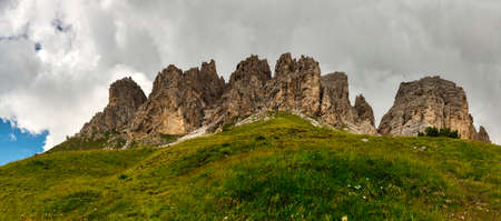 Panorama of the Cir group with grass in the foreground, Dolomites - Trentino-Alto Adige, Italy