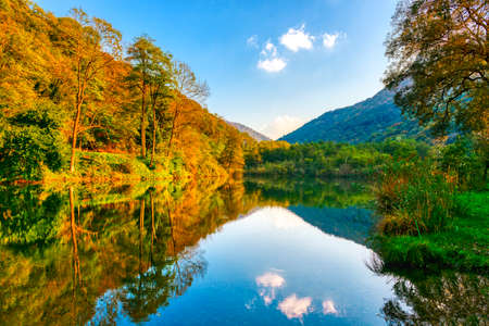 Autumn colors in the forest and lake of Brinzio near Varese city