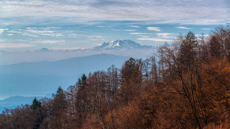 Landscape on the Monte Rosa massif in fall season with forest in foreground, Regional park of Campo dei Fiori Varese