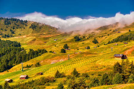 Clouds over the hills of Seceda in fall season, South Tyrol Dolomites Archivio Fotografico