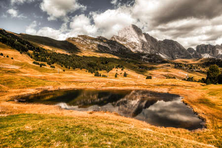 Landscape of Holy Lake and Seceda in the natural park of Puez-Odle in the Dolomites, South Tyrol - Italy