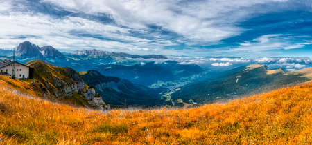 Infrared Landscape on the Gardena Valley from Seceda in autumn season with cloudy sky, Alto Adige