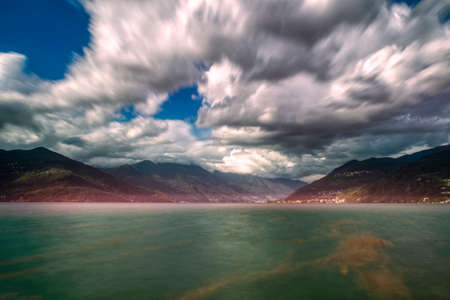 Long time exposure landscape on the Major Lake and cloudy sky, Luino Archivio Fotografico