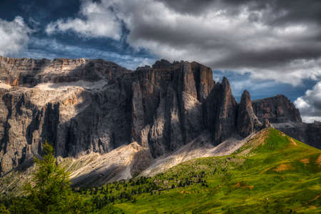 Infrared landscape of Group of Sella in summer season with dark clouds in the sky Standard-Bild