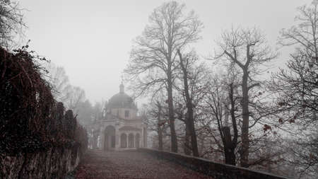 Foggy winter morning on the mountain path of Sacred Mount of Varese