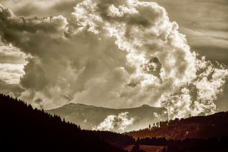 Thunderstorm formation over the top of highland Sciliar in the Dolomites, Italian Alps