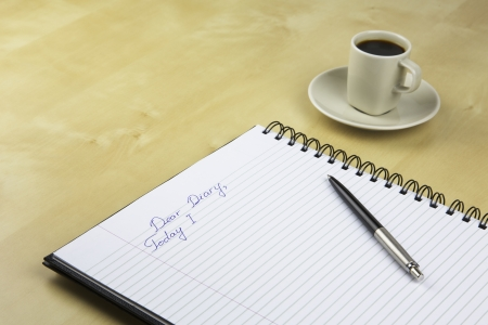 An Unfinished Record in a Diary with a Cup  of Coffee on a Background Stock Photo - 15085836
