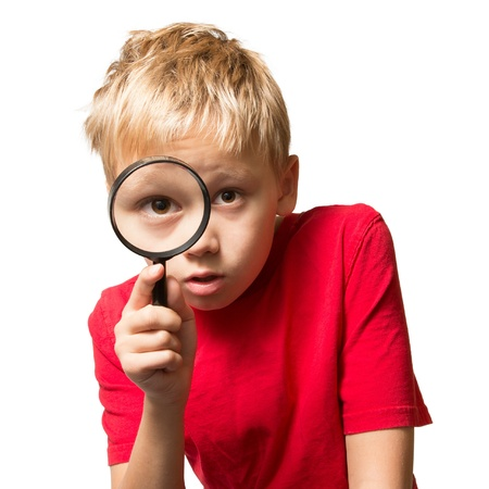 A Young Boy looking at You thru thez Magnifier Glass Imagens - 16727280