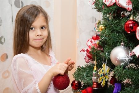 Young Girl Decorating Christmas Tree photo