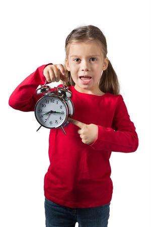 Young Girl Showing Alarm Clock, Isolated on White photo