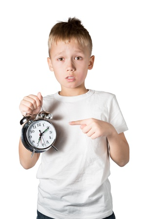 preteen boy: Young Boy Showing Alarm Clock, Isolated on White