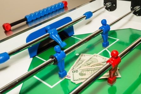 Foosball Table with Money On It photo