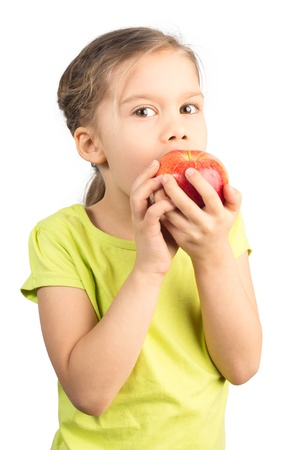Pretty Young Girl Eating Apple, Isolated on White photo
