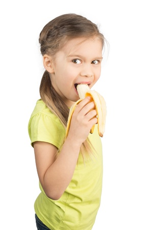 Pretty Young Girl Eating Banana, Isolated on White photo
