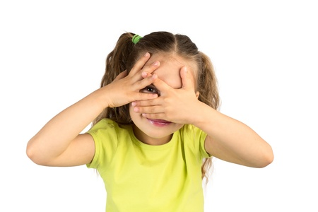 Cute Little Girl Covering Her Eyes While Watching Through the Gap in Fingers, Isolated photo