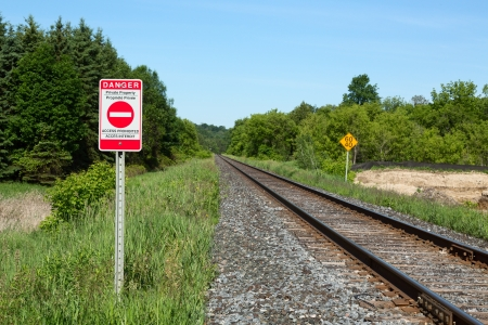 property: Railroad and Bilingual English-French Private Property Warning Sign Stock Photo