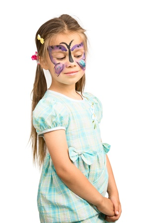 humorously: Little Girl With Butterfly Painting on Humorously Shy Face, Isolated Stock Photo