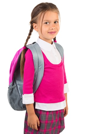 Beautiful little girl in pink school uniform and a backpack, isolated Imagens