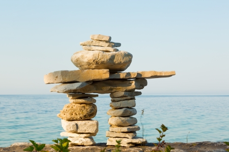 inukshuk: An inukshuk on a shore of Lake Huron, Bruce Peninsula, Ontario, Canada