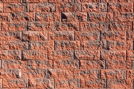 sidelit: A textured high-contrast red brick wall Stock Photo