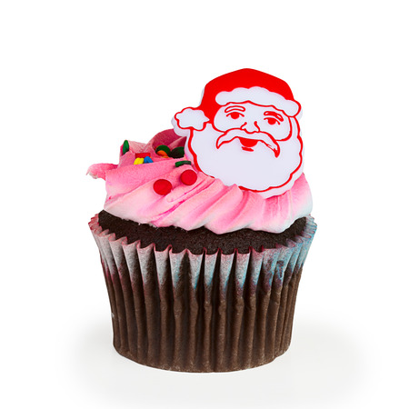 cupcakes isolated: A colorful cupcake with toy Santa on top, isolated