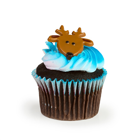 A colorful cupcake with toy reindeer on top photo