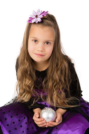 kanzashi: Beautiful girl in a dark purple dress holding christmas tree decordation, Isolated
