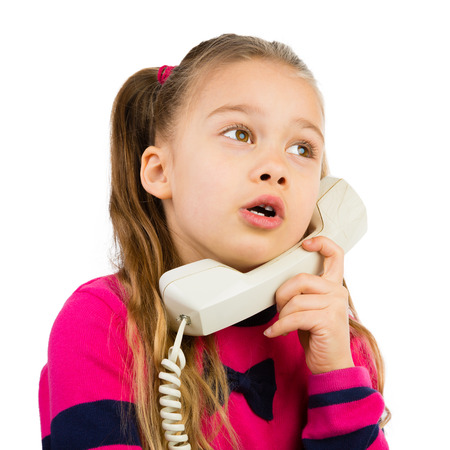 chit chat: Pretty young girl talking by the corded telephone, isolated