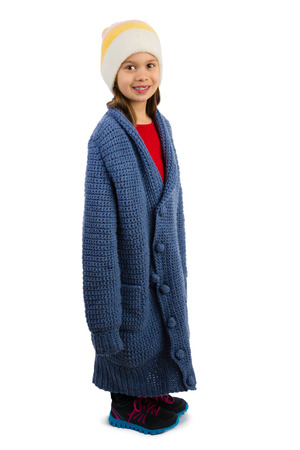 oversized: Cute little girl dressed in oversized cardigan buttonned in a wrong way, isolated
