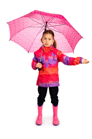 Little girl with big pink umbrella checking if it