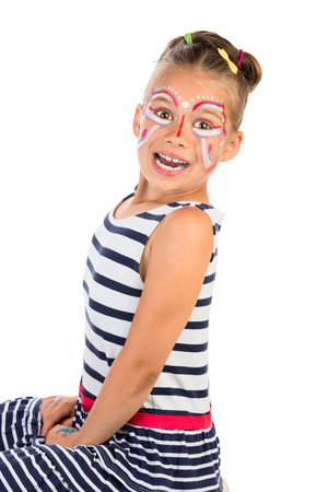 A portrait of very excited young girl with abstract face painting applied, isolated photo