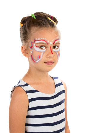 Serious little girl with abstract design paint on her face  Isolated photo