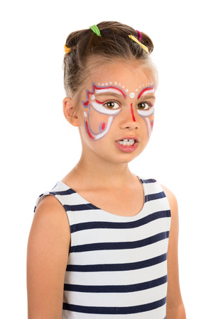 Serious little girl with an open mouth, abstract design paint on her face  Isolated