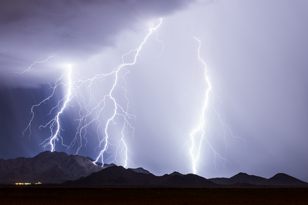 Thunderstorm with bright lightning strikes 版權商用圖片