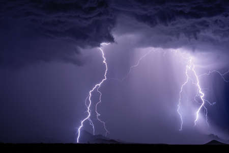 Lightning bolts and heavy rain from a thunderstorm.