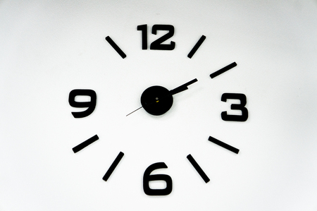 Analog clock with black arrows on a white background