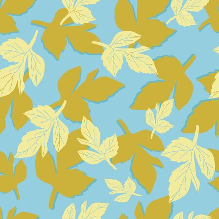 Yellow and mustard leaves on blue background.