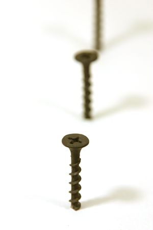 dilsiz: Screws in Line with focus on the first Stock Photo