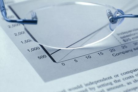 Glasses and the Budget Reports Stock Photo