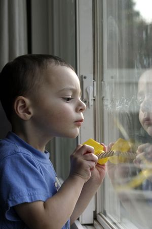 concentrating: Child concentrating on his task in hand