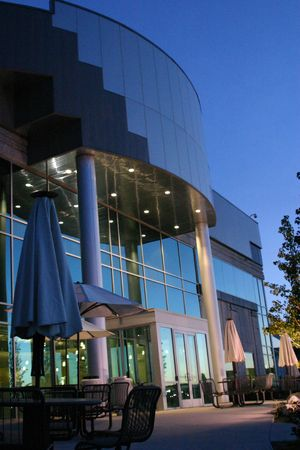 Blue Building with cafeteria tables