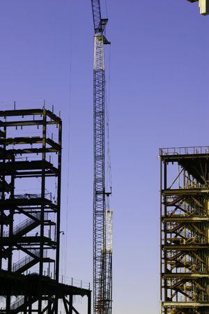 zoomed in: Construction site& the Crane- Zoomed in Stock Photo