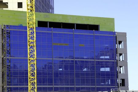dilsiz: Close up on the Construction site - Crane and the Building Stock Photo