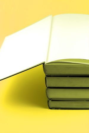 Books stacked up with the cover open on the top Stock Photo - 291690