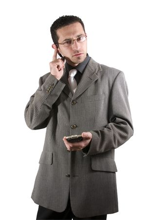 earpiece: Businessman on the phone with PDA in hand and an earpiece Stock Photo