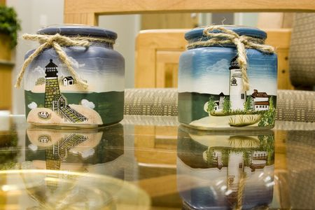 Lighthouse Candle Holders on glass table in a doctors office photo