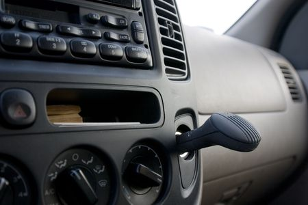 ionizer: Close up on a dashboard with the radio and the plug in ionizer