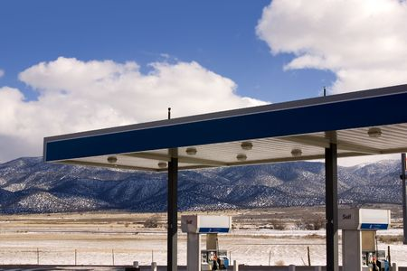fueling pump: Gas Station with fields and Mountains on the background