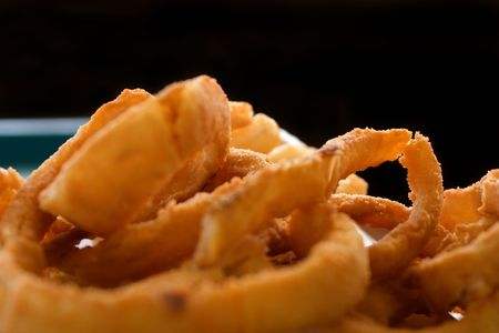 Close up shot of Onion Rings with Black Background